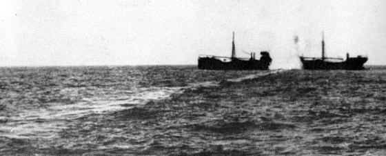 A unarmed cargo vessel is struck by a German torpedo.