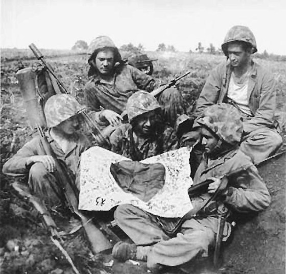 American troops with a Japanese flag. One sailor remembers how he brought a Rising Sun home from Okinawa. (Image source: WikiCommons)