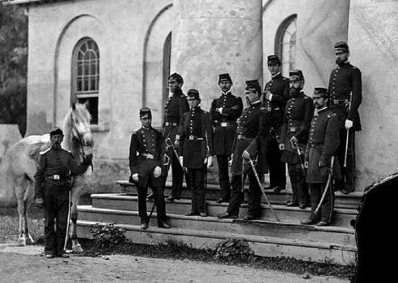 Union troops pose on the steps of the Lee family estate at Arlington.