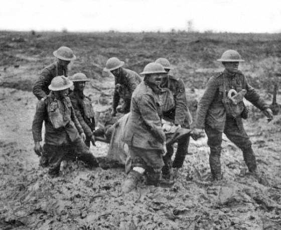 Medics carry a wounded soldier from the Western Front in 1917. (Image source: WIkiCommons)