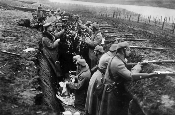 German troops erect a Christmas tree in a trench somewhere at the front. (Image source: WikiCommons)