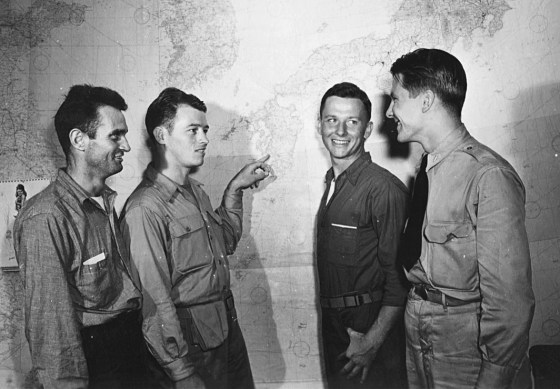 Survivors Joe Barta, Mac McDole, and Doug Bogue indicate Palawan on a map to an intelligence officer after their return to the United States in 1945. (Image source: Kathy McDole Parkins)