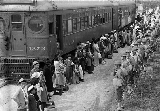Japanese Americans are held under guard at the Santa Anita Assembly Area, Arcadia, California. (Image source: WikiCommons)