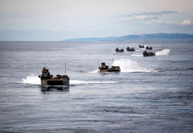 Japan Ground Self-Defense Force amphibious assault vehicles approach the amphibious transport dock ship USS Somerset (LPD 25) during Exercise Iron Fist 2019. (U.S. Navy photo by Mass Communication Specialist 2nd Class Devin M. Langer)