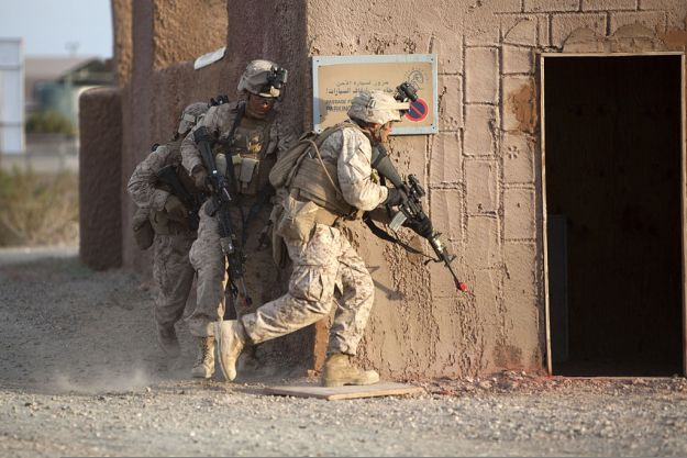 Marines prepare to breach a building during a mock helicopter raid at Yuma Proving Ground