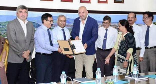 HSL CMD Rear Admiral (retired) L.V. Sarat Babu and a delegation from Turkey exchanging documents for Fleet Support Ship project in Visakhapatnam on Tuesday.