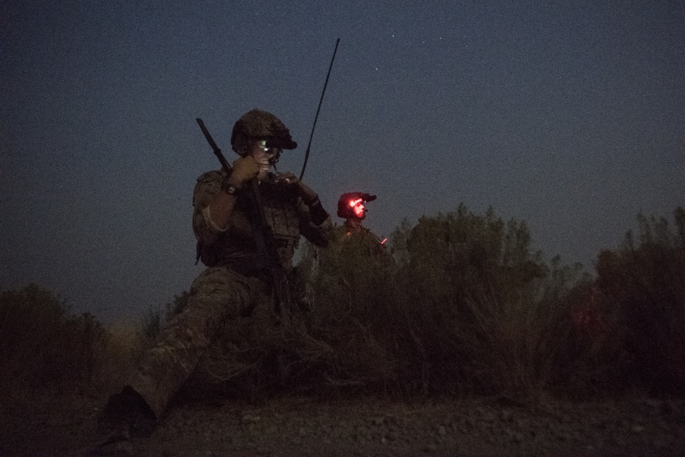 Special Tactics Airmen with the 17th Special Tactics Squadron reviews target positions during Jaded Thunder at Mountain Home Air Force Base, Idaho, Aug. 20, 2018. Special Tactics Airmen are a ground force that maximize the impacts of air power by controlling and directing precise strikes to destroy enemy terrain, positions and resources. (U.S. Air Force photo by Tech. Sgt. Sandra Welch)