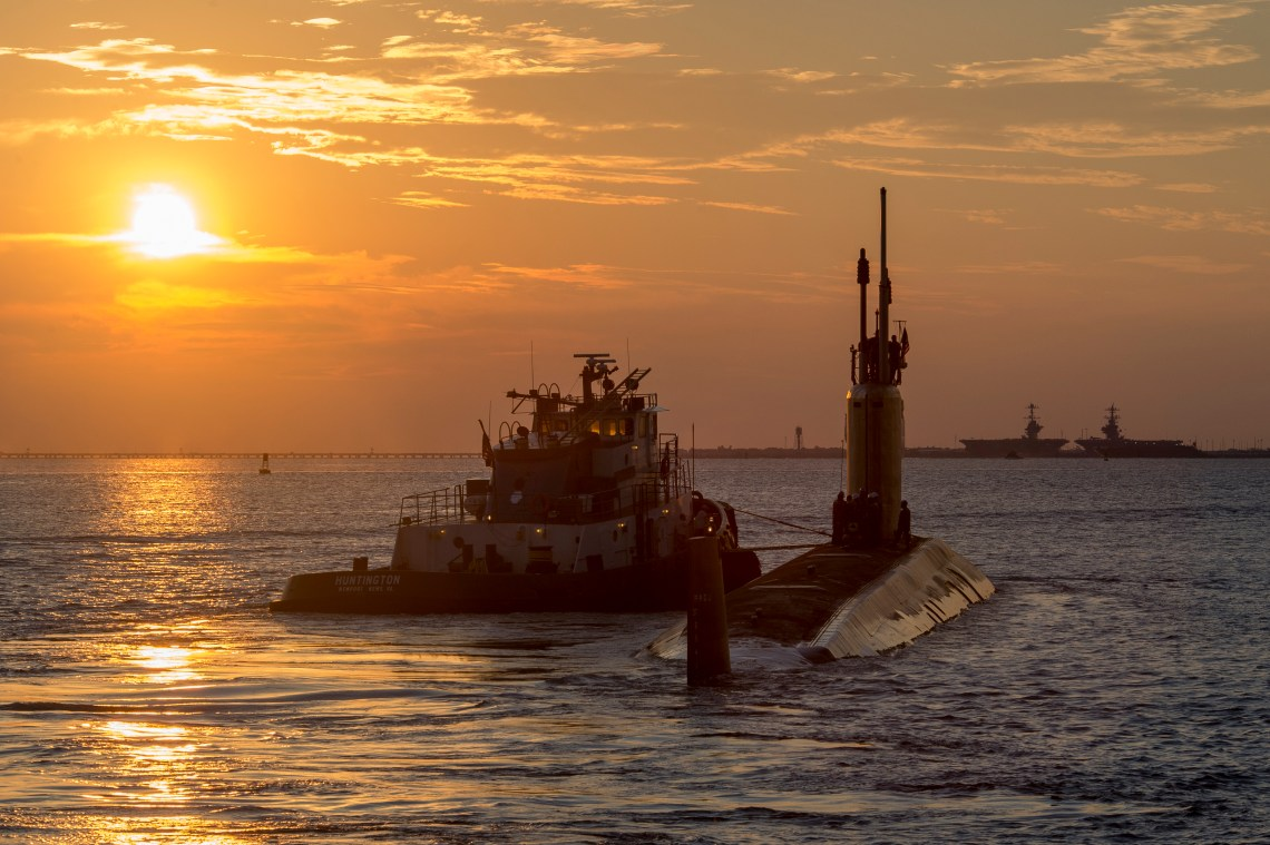 The submarine USS John Warner (SSN 785) is pictured leaving Newport News Shipbuilding on sea trials as part of its post shakedown availability. It is the first PSA to be accomplished without having to put the boat into a dry dock for external hull work. Photo by John Whalen/HII
