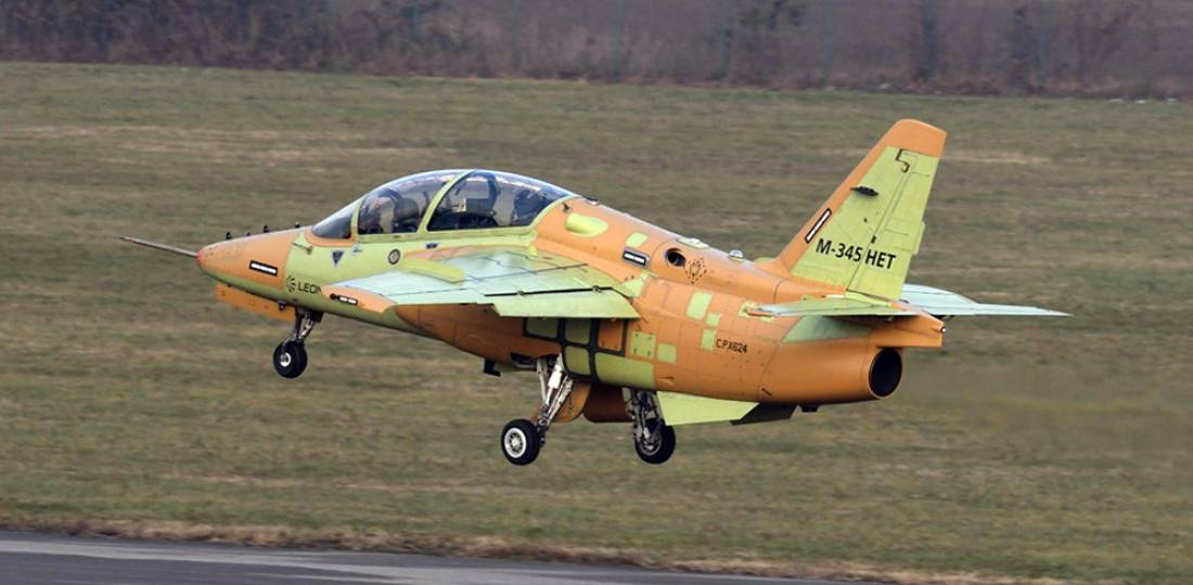 The first production Aermacchi M-345 HET returns to Venegono Superiore airport at Varese, Italy, after its successful first flight.