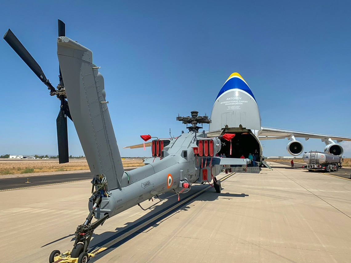 Boeing has contracted Ukraine's Antonov Airlines to transport its AH-64 Apache attack helicopters to India. An An-124 is shown here loading an Apache painted in Indian Air Force markings at Boeing's plant in Phoenix, Arizona.