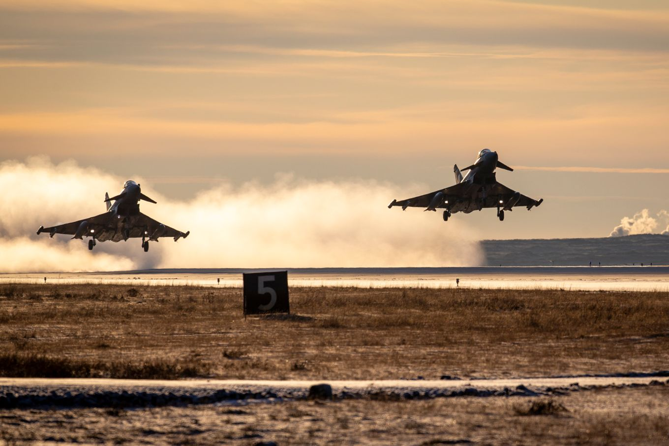 Two 1(F) Squadron Eurofighter Typhoon FGR4s take-off from Keflavik Air Base as part of the NATO Icelandic Air Policing mission