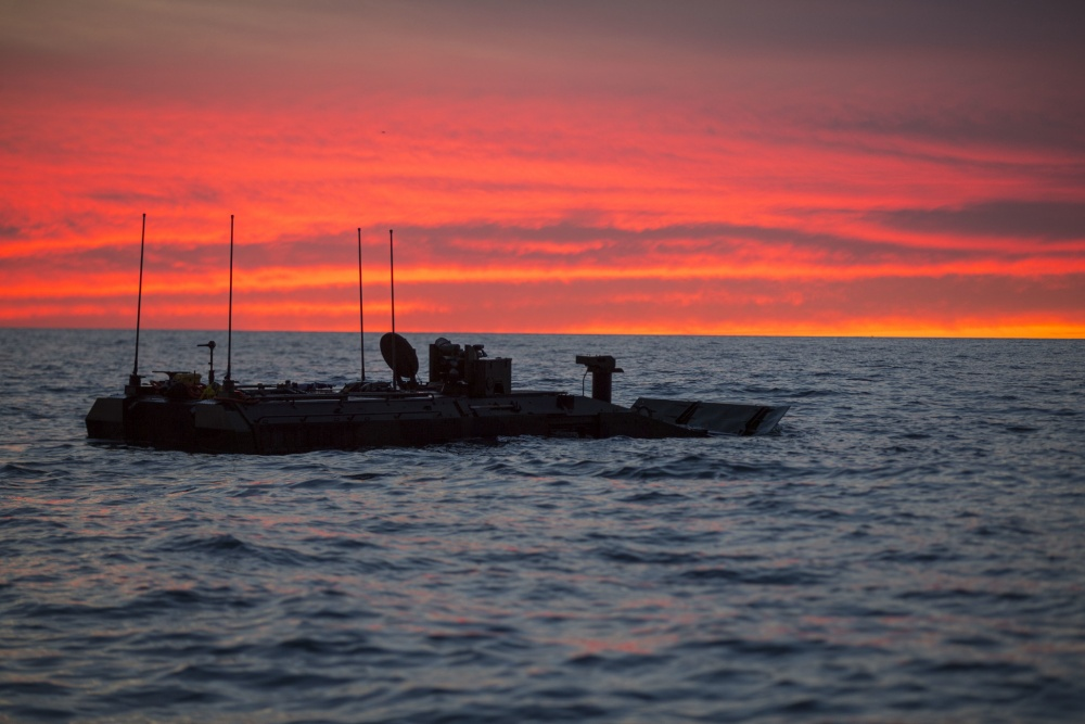 U.S. Marines with Amphibious Vehicle Test Branch, Marine Corps Tactical Systems Support Activity, take a new Amphibious Combat Vehicle out for open ocean low-light testing at Del Mar Beach on Marine Corps Base Camp Pendleton, California, Dec. 17, 2019.