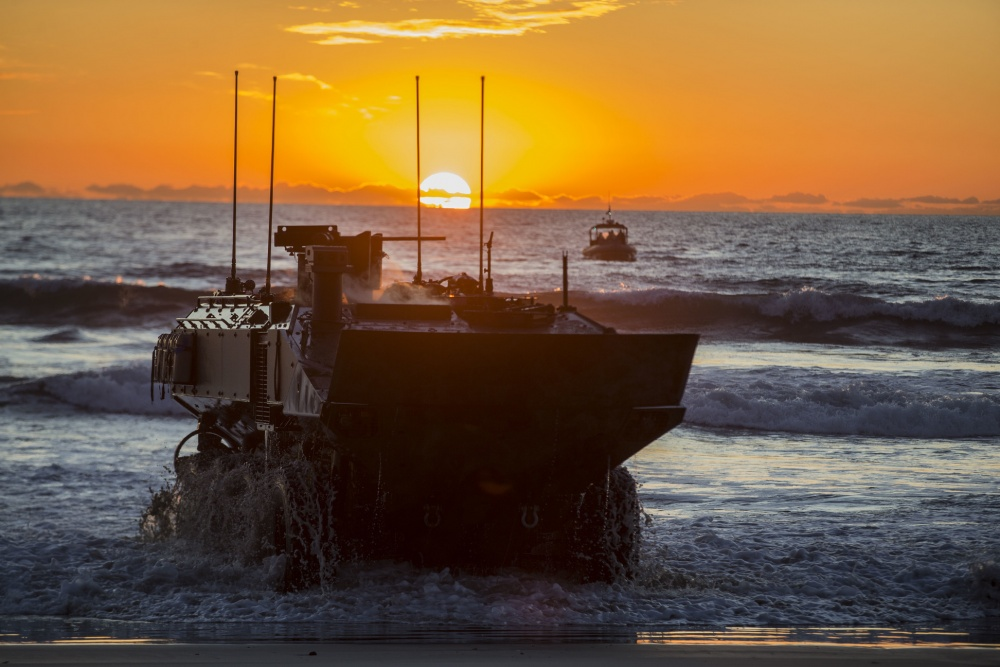U.S. Marines with Amphibious Vehicle Test Branch, Marine Corps Tactical Systems Support Activity, drive a new Amphibious Combat Vehicle ashore during low-light surf transit testing at AVTB Beach on Marine Corps Base Camp Pendleton, California, Dec. 18, 2019. The test was designed to assess and verify how well Marines can interface with the vehicle and operate at night. The ACV is an eight-wheeled armored personnel carrier designed to fully replace the Corps' aging fleet of Amphibious Assault Vehicles. (U.S. Marine Corps photo by Lance Cpl. Andrew Cortez)