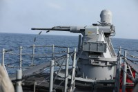 A MK-38 machine gun aboard the coastal patrol ship USS Sirocco (PC 6) fires rounds at simulated enemy ships as part of Griffin Missile Exercise 19. The exercise demonstrated a proven capability for the ships to defend themselves against small boat threats and ensure maritime security through key chokepoints in the U.S. Central Command area of responsibility.