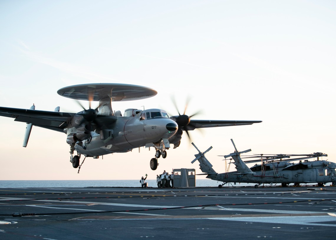 An E-2D Advanced Hawkeye assigned to Air Test and Evaluation Squadron (VX) 20 lands aboard the aircraft carrier USS Gerald R. Ford (CVN 78). The arrestment marked the first time an E-2D had landed aboard Gerald R. Ford. Gerald R. Ford is currently conducting aircraft compatibility testing to further test its electromagnetic aircraft launch systems and advanced arresting gear.