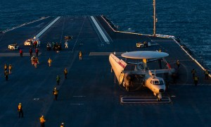 Sailors assigned to the aair department aboard the aircraft carrier USS Gerald R. Ford (CVN 78) direct an E-2D Advanced Hawkeye assigned to Air Test and Evaluation Squadron (VX) 20 on during flight operations. Gerald R. Ford is currently conducting aircraft compatibility testing to further test its electromagnetic aircraft launch systems and advanced arresting gear.