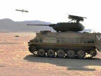 A Rafael Samson unmanned weapon station mounted on a M113 APC launches a Spike LR missile.