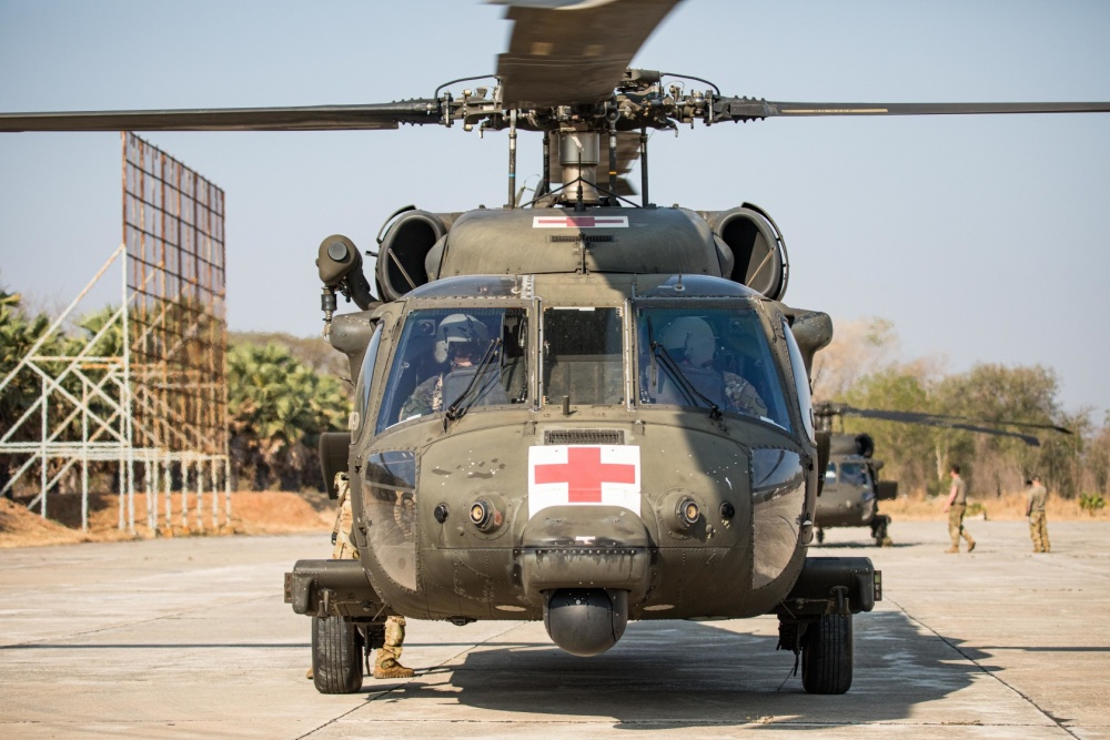 Army aviators from Charlie Company, 3rd Battalion, 25th Aviation Regiment, 25th Combat Aviation Brigade conduct preflight checks during a medevac rehearsal conducted with Soldiers of 2nd Battalion, 35th Infantry Regiment and medical personnel from the Bangkok Ratchasima Hospital