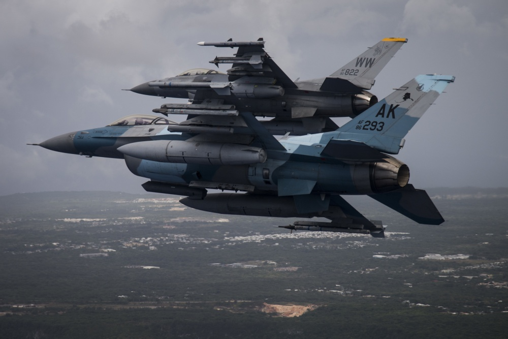 A U.S. Air Force F-16C Fighting Falcon, foreground, assigned to the 18th Aggressor Squadron, Eielson Air Force Base, Alaska, and a F-16CJ, assigned to the 14th Fighter Squadron, Misawa Air Base, Japan, approach to land during exercise COPE North 20, at Andersen Air Force Base, Guam, Feb. 19, 2020. (U.S. Air Force photo by Master Sgt. Larry E. Reid Jr.)