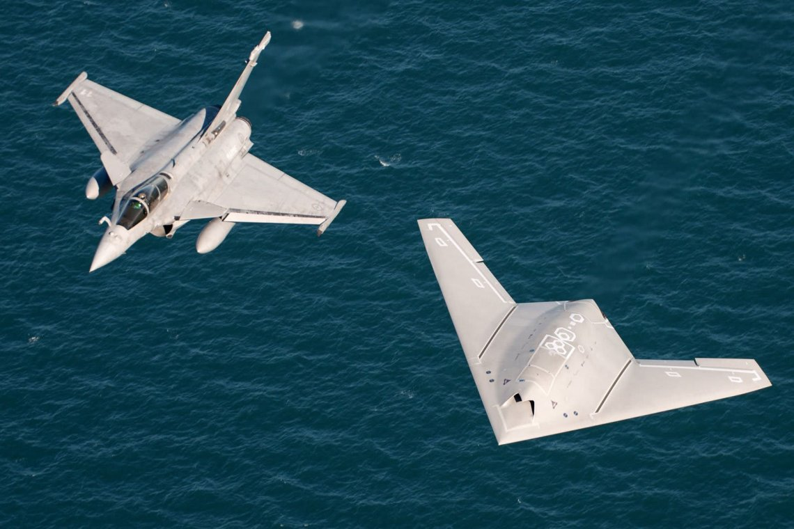 nEUROn and Rafale M in flight over the Charles de Gaulle aircraft carrier.