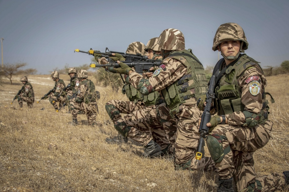Moroccan soldiers from the 2nd Battalion Infantry Paratroopers engage a simulated enemy during the opening days of Flintlock near Thies, Senegal, Feb. 16, 2020.