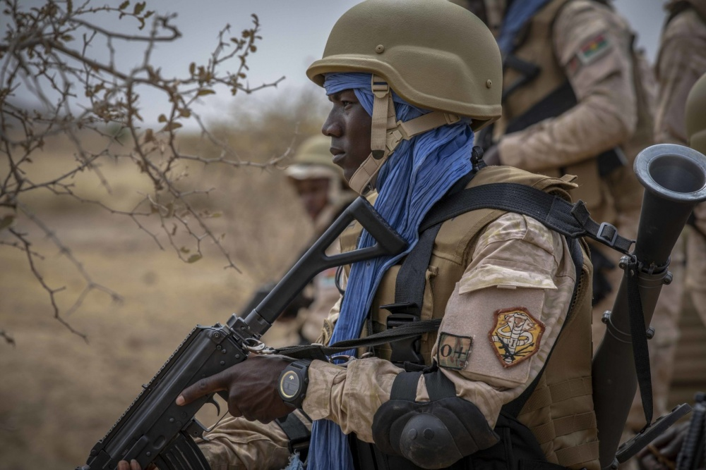 A Burkinabe soldier pulls security before a training patrol during the opening days of Flintlock 20 near Thies, Senegal, Feb. 16, 2020.