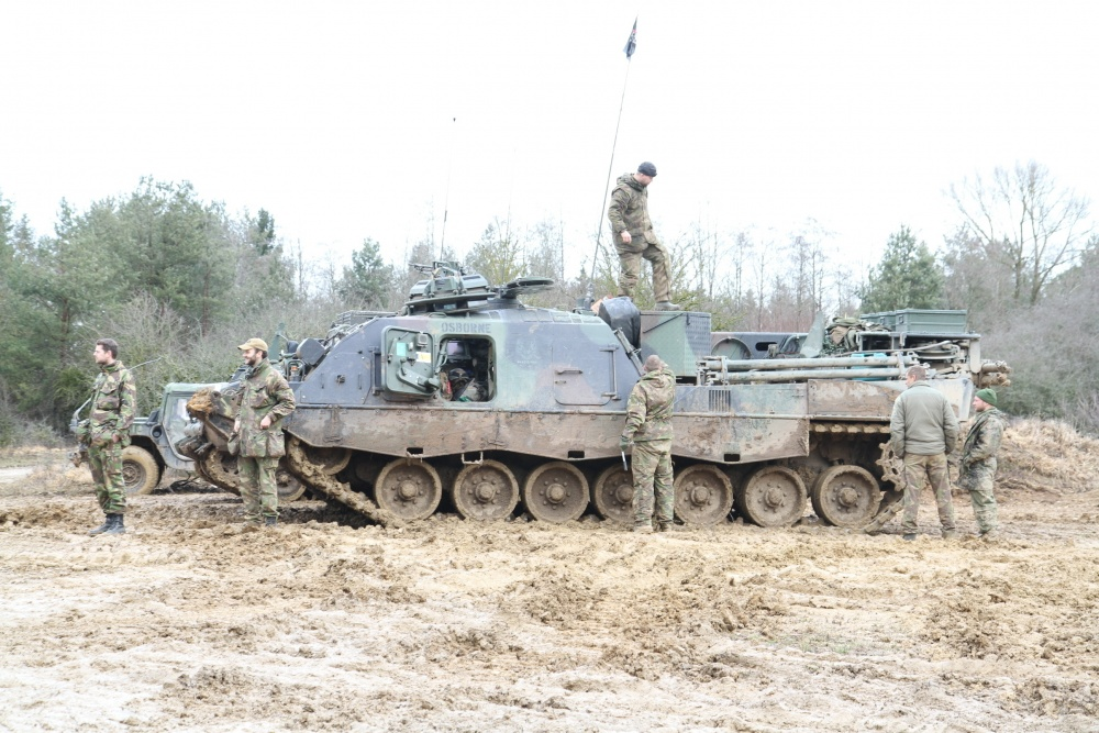 Dutch soldiers stand outside their tank after the end of training exercise Combined Resolve XIII at the Joint Multinational Readiness Center, Hohenfels, Germany.