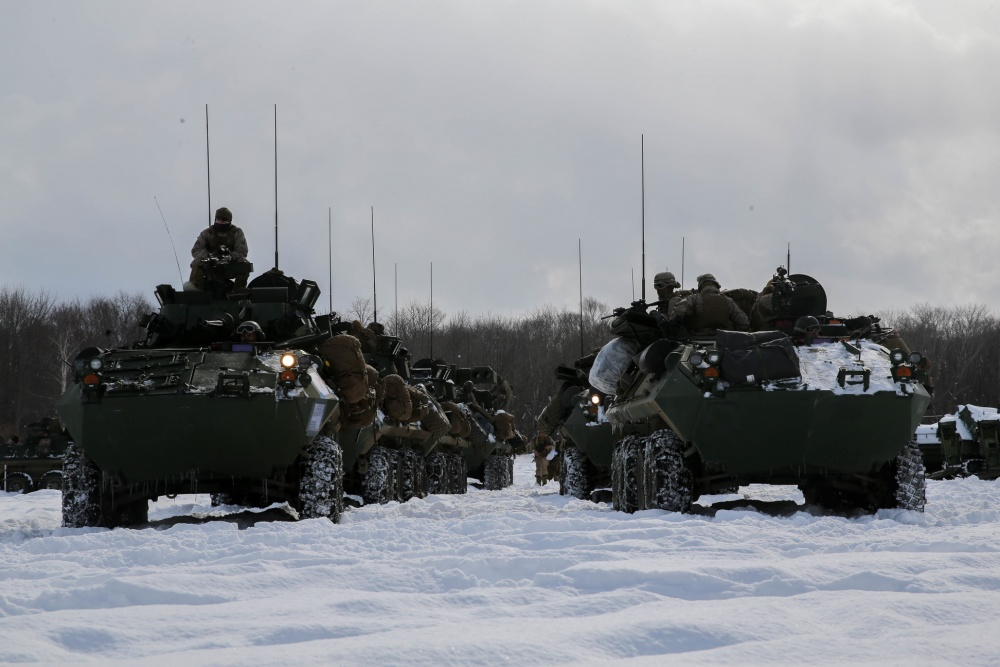 Light Armored Vehicles from 3rd Light Armored Reconnaissance Battalion, Combat Assault Battalion, 3rd Marine Division, prepare to cross the line of departure and begin their comprehensive exercise assault during exercise Northern Viper 2020