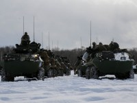Light Armored Vehicles from 3rd Light Armored Reconnaissance Battalion, Combat Assault Battalion, 3rd Marine Division, prepare to cross the line of departure and begin their comprehensive exercise assault during exercise Northern Viper 2020 at Hokudaien Training Area, Hokkaido, Japan, Feb. 4, 2020.