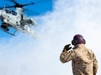 """A U.S. Marine Corps AH-1Z Viper with Marine Light Attack Helicopter Squadron 369 """"Gunfighters"""" prepares to land on a Combat Aircraft Loading Area for hot-loading during exercise Northern Viper"""