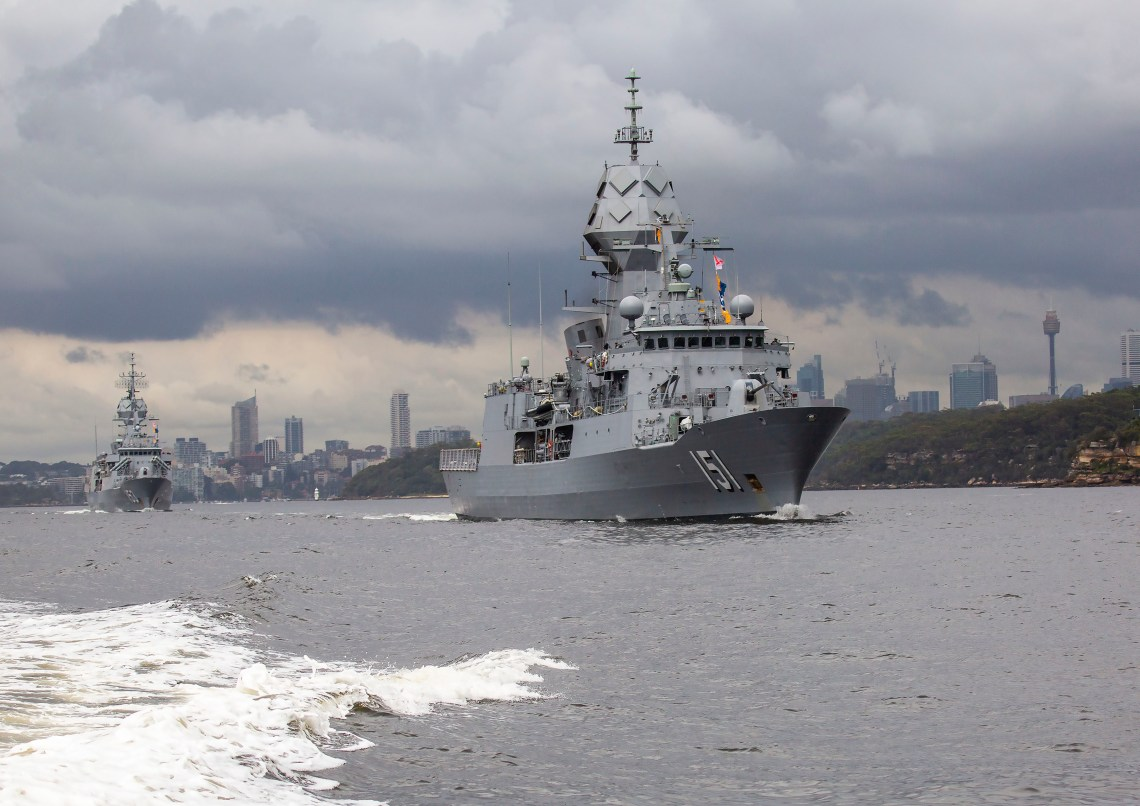 HMAS Arunta followed by HMAS Stuart depart Sydney Harbour for the Royal Australian Navy's Fleet Certification Period, 2020.