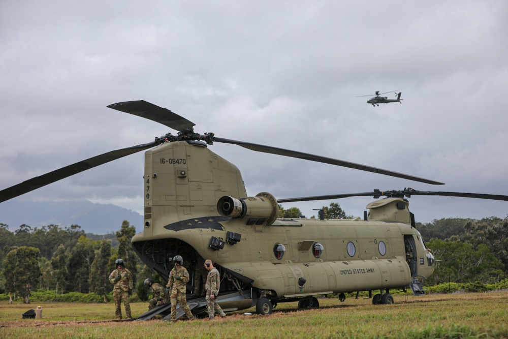 "Petroleum Supply Specialists using the CH-47F Chinook helicopter from B. Co, 3-25 ""Hammerheads"" as a fuel source for other aircraft."