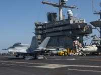 An F/A-18F Super Hornet, attached to the Fighting Checkmates of Strike Fighter Squadron (VFA) 211, lands on the flight deck of the aircraft carrier USS Harry S. Truman (CVN 75) in the Arabian Sea Feb. 1, 2020.