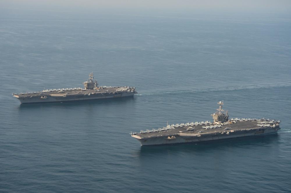 The aircraft carriers USS Dwight D. Eisenhower (CVN 69), left, and USS Harry S. Truman (CVN 75) transit the Arabian Sea March 18, 2020.