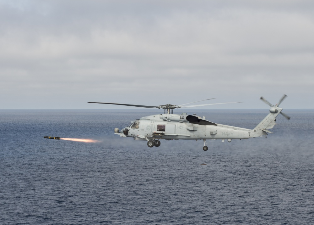 A Sikorsky MH-60R Romeo helicopter attached to the Raptors of Helicopter Maritime Strike Squadron (HSM) 71 fires an AGM-114 Hellfire missile during a training exercise over the Pacific Ocean.
