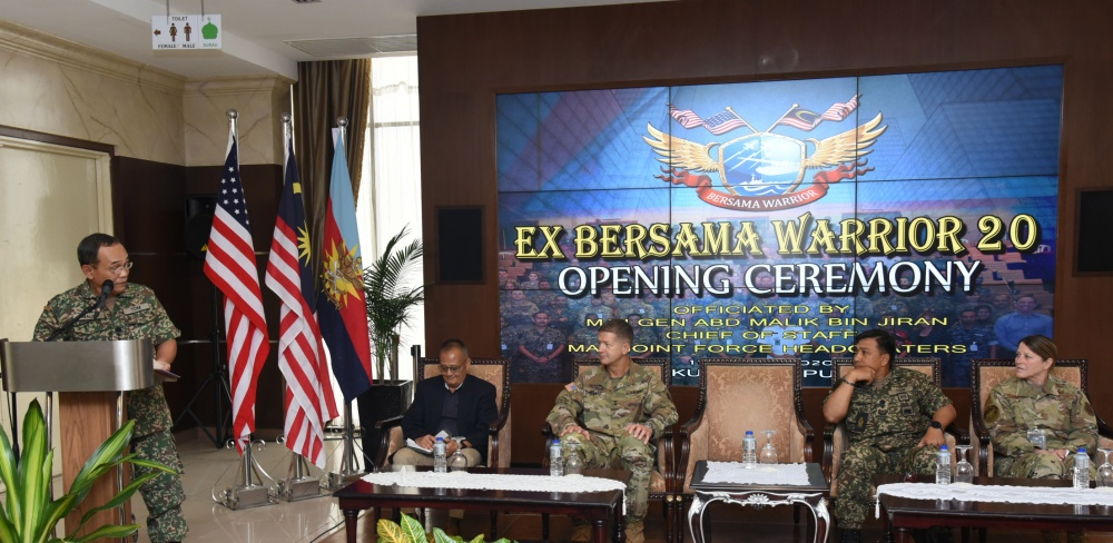 Malaysia Armed Forces Joint Force Headquarters Chief of Staff Maj. Gen. Abd Malik bin Jiran officiates the opening ceremony of Bersama Warrior on March 11, 2020 at the Malaysia Armed Forces Joint Force Headquarters in Kuala Lumpur. Also pictured, from left to right, is U.S. Army U.S. Indo-Pacific Command, Pacific Warfighting Center Director Mr. Paul Tamaribuchi, 25th Infantry Division Commander Major General James B. Jarrard, 12th Malaysian Infantry Brigade Commander Brig. Gen. Datuk Marzuki bin HJ Mokhtar, and Special Assistant to the Director of the Air National Guard Brig. Gen. Jill A. Lannan.
