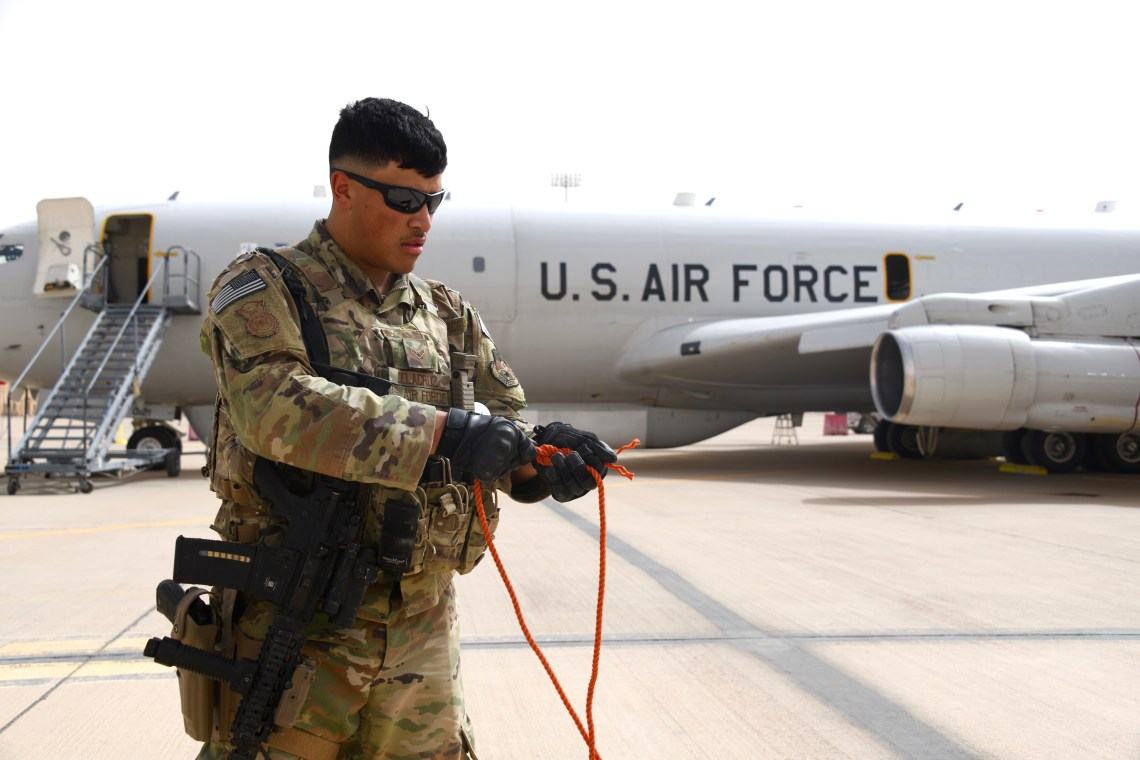 U.S. Air Force Airman 1st Class Christian Delacruz, 378th Expeditionary Security Forces Squadron defender, establishes a security perimeter around an E-8C Joint Surveillance Target Attack Radar System (JSTARS) at Prince Sultan Air Base, Kingdom of Saudi Arabia, March 8, 2020.