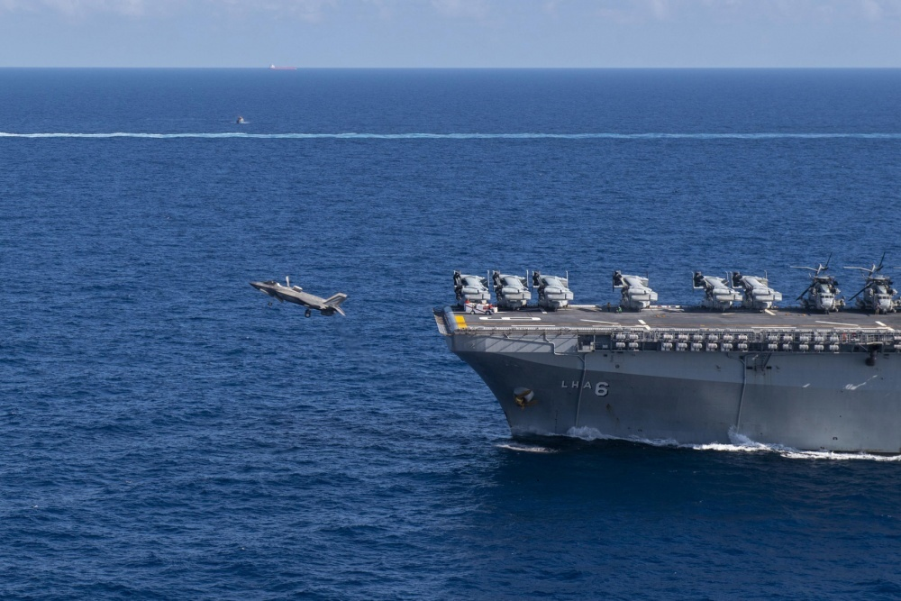 An F-35B Lightning II assigned to the 31st Marine Expeditionary Unit (MEU), Marine Medium Tiltrotor Squadron (VMM) 265 (Reinforced) takes off from the flight deck of amphibious assault ship USS America (LHA 6).