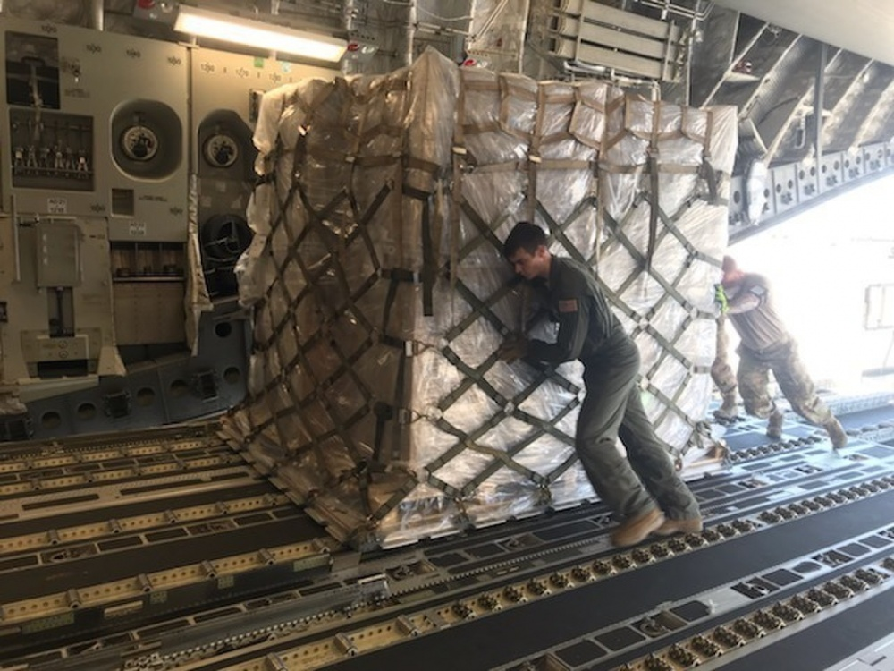 The 167th Airlift Wing transported just over one million COVID-19 test kits from Aviano Air Base, Italy to Memphis, Tenn., April 16, 2020. The test kits, which are maunufactured in Italy, will be distributed throughout the nation from the Fed Ex hub in Tennessee. Eighteen pallets filled the cargo compartment of the C-17 Globemaster III aircraft, crewed by seven 167th AW Airmen. (U.S. Air National Guard photos by Maj. Tim Siemer)
