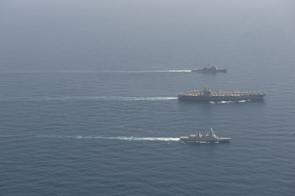 The aircraft carrier USS Dwight D. Eisenhower (CVN 69), center, the guided-missile cruiser USS San Jacinto (CG 56), top, and the French anti-air frigate Forbin (D620) conduct a group-sail exercise in the Arabian Sea, April 25, 2020. Ike, San Jacinto and Forbin are operating under national tasking, as they participate in a bilateral, interoperability exercise to strengthen partnership between the U.S. and French navies. (U.S. Navy photo by Mass Communication Specialist Seaman Apprentice Orion K. Shotton)