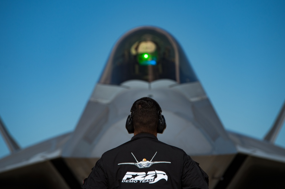 U.S. Air Force Senior Airman Carlos Paonessa, F-22 Demonstration Team dedicated crew chief, marshals Maj. Joshua Gunderson, F-22 Demonstration Team pilot, before takeoff during Air Force Heritage Flight Training Course attendees, at Davis-Monthan Air Force Base, Arizona, Feb. 29, 2020. The U.S. Air Force Heritage Flight program shows the evolution of U.S. Air Force air craft by flying today's fighter aircraft in formation with historical fighter aircraft. (U.S. Air Force photo by Senior Airman Tristan Biese)