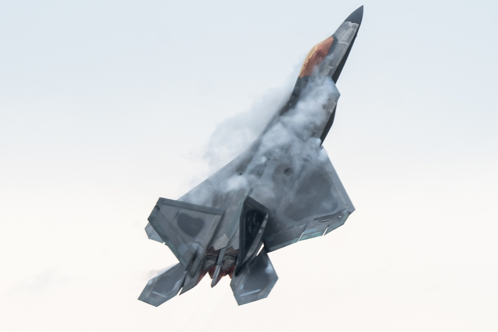 U.S. Air Force Maj. Josh Gunderson, F-22 Raptor Demonstration Team commander and pilot, pulls into a maximum vertical climb during an aerial demonstration at Joint Base Langley-Eustis, Va., March 30, 2020. Maj. Gunderson has over 1,500 hours flying both the F-15 Eagle and F-22 Raptor and is in his first year as commander of the F-22 Raptor Demo Team. (U.S. Air Force photo by Lt. Sam Eckholm)