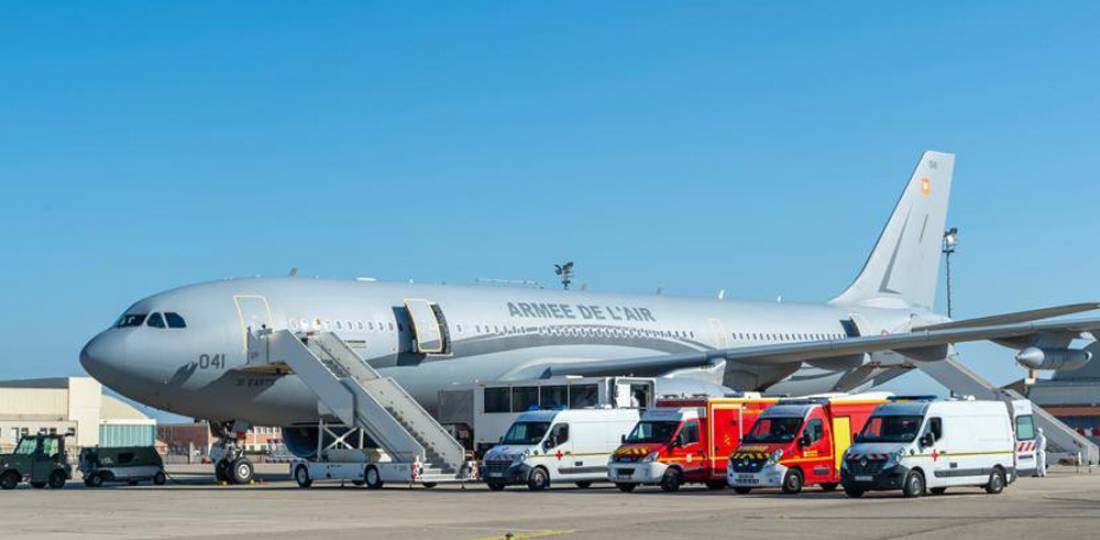 Setup of the A330 with ambulance cars to begin medical evacuation of intensive care patient in support France's fight against COVID-19. Photo courtesy French Air Force