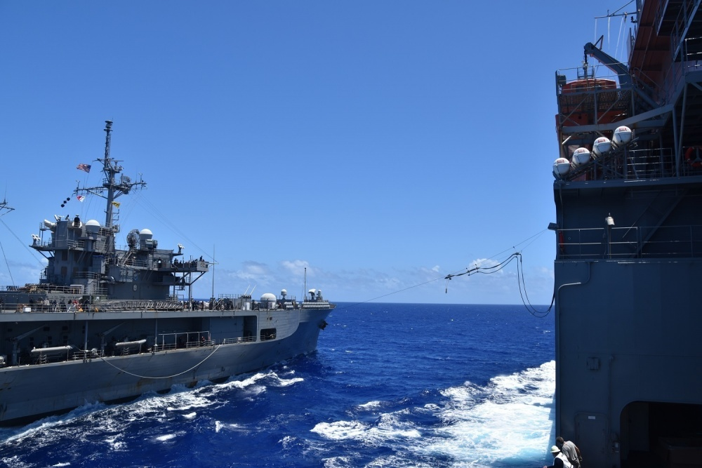 U.S. 7th Fleet flag ship USS Blue Ridge (LCC 19), left, and the Lewis and Clark-class dry cargo and ammunition ship USNS Richard E. Byrd (T-AKE 4) conduct an emergency breakaway drill after the two ships completed a replenishment-at-sea. (U.S. Navy photo by Charles Baker)