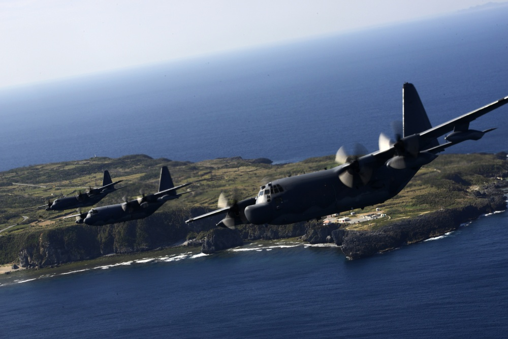 From left, an MC-130J Commando II and an MC-130P Combat Shadow both from the 17th Special Operations Squadron along with an MC-130H Combat Talon II from the 1st Special Operations Squadron conduct a heritage formation of three MC-130 variants off the coast of Okinawa, Japan,