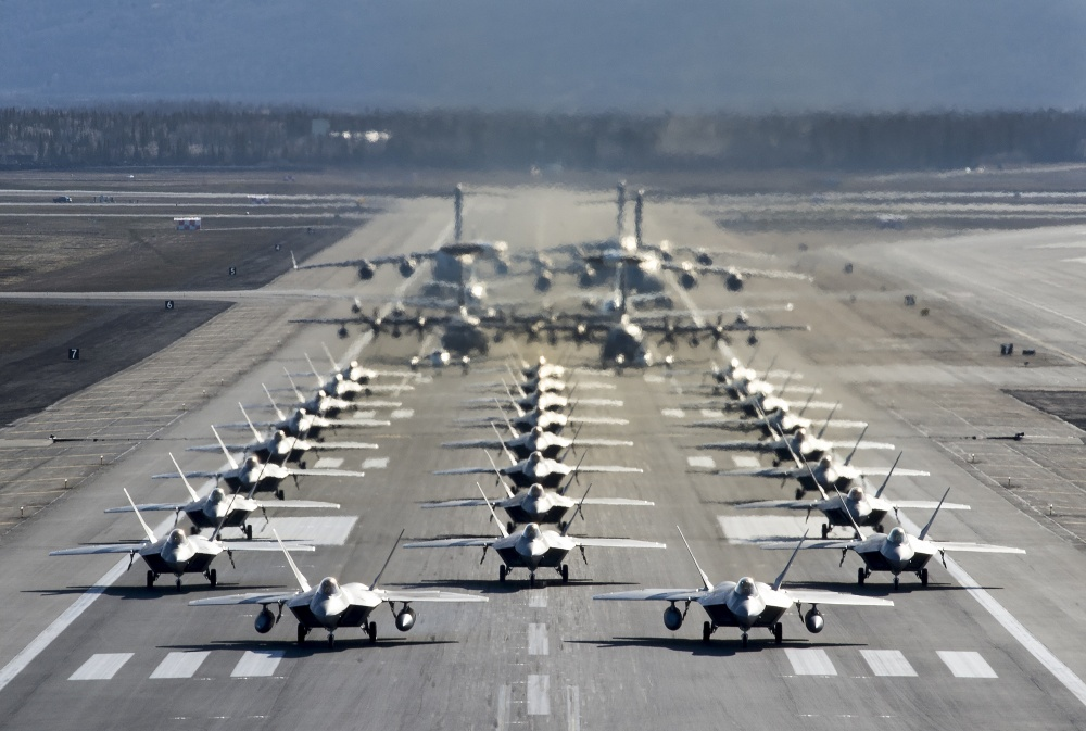 U.S. Air Force F-22 Raptors, E-3 Sentrys, C-17 Globemaster IIIs, C-130J Herculeses and C-12F Hurons participate in a close formation taxi known as an elephant walk at Joint Base Elmendorf-Richardson, Alaska, May 5, 2020. This event displayed the ability of the 3rd Wing, 176th Wing and the 477th Fighter Group to maintain constant readiness throughout COVID-19 by Total Force Integration between active-duty, Guard and Reserve units to continue defending the U.S. homeland and ensuring a free and open Indo-Pacific. (U.S. Air Force photo by Senior Airman Jonathan Valdes Montijo)