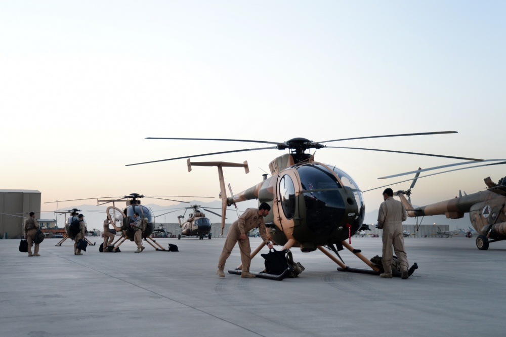 Afghan Air Force pilots walk out to MD-530 Cayuse Warrior, or 'Jengi' in Dari, prior to an all-Afghan combat mission. The crews flew out of Hamid Karzai International Airport, Kabul, Afghanistan, Sept. 27, 2015. The 'Jengi' is a light-lift, highly maneuverable attack helicopter used for high altitude operations. (U.S. Air Force photo by Staff Sgt. Sandra Welch/released)