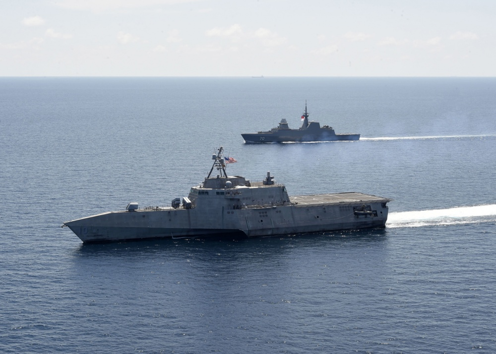 The Independence-variant littoral combat ship USS Gabrielle Giffords (LCS 10), left, exercises with the Republic of Singapore Navy Formidable-class multi-role stealth frigate RSS Steadfast (FFS 70) in the South China Sea, May 25, 2020.