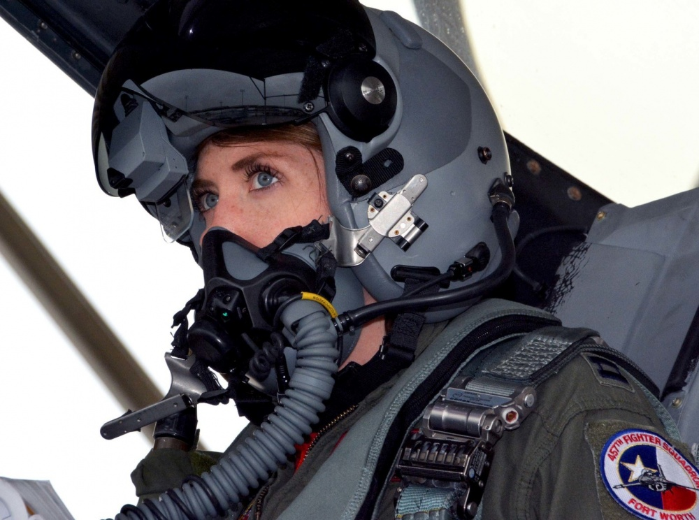 "Capt. Michelle ""Mace"" Curran, 355th Fighter Squadron F-16 pilot, looks up during launch preparations on the flightline, March 4, 2017. Curran was the first woman assigned to fly in the squadron and attributed her success to her parents, leadership and strong women in aviation past and present who've helped pave the way. (U.S. Air Force photo by Staff Sgt. Samantha Mathison)"