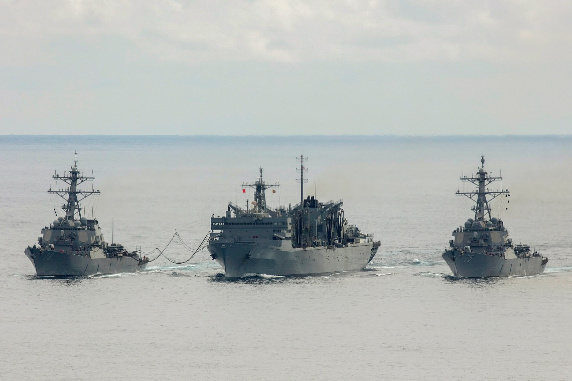 The Arleigh Burke-class guided-missile destroyers USS Donald Cook (DDG 75) and USS Porter (DDG 78) conduct a connected replenishment with the USNS Supply (T-AOE 6) to receive fuel and stores, April 28, 2020.  (U.S. Navy photo Yeoman 3rd Class Anthony Nichols/Released